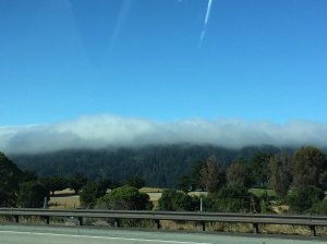 The clouds hang just over the mountain side creating a amazing view - Tech Break Blog